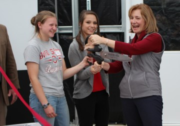 Dean Cathann Kress, alongside students, cuts the ribbon at ATI greenhouse dedication ceremony.